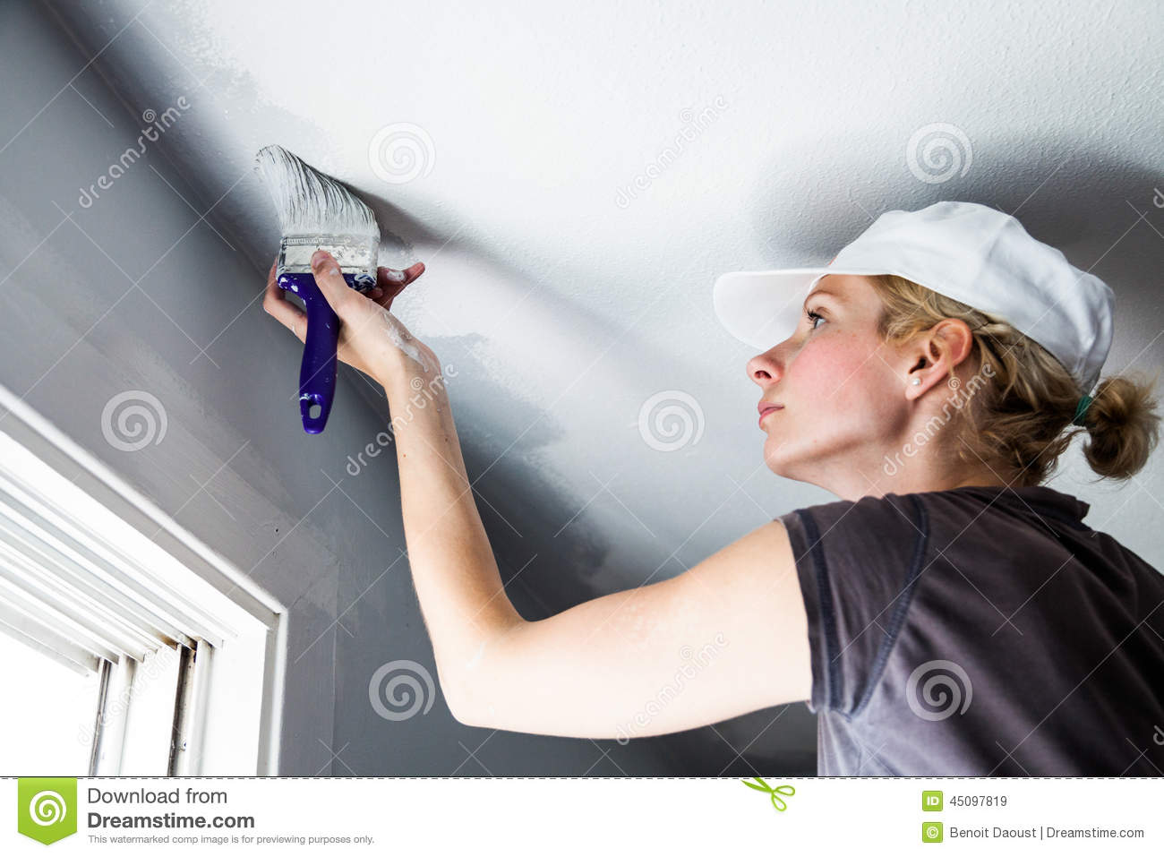 Woman Painting The Edges Of The Ceiling Stock Image - Image of ...