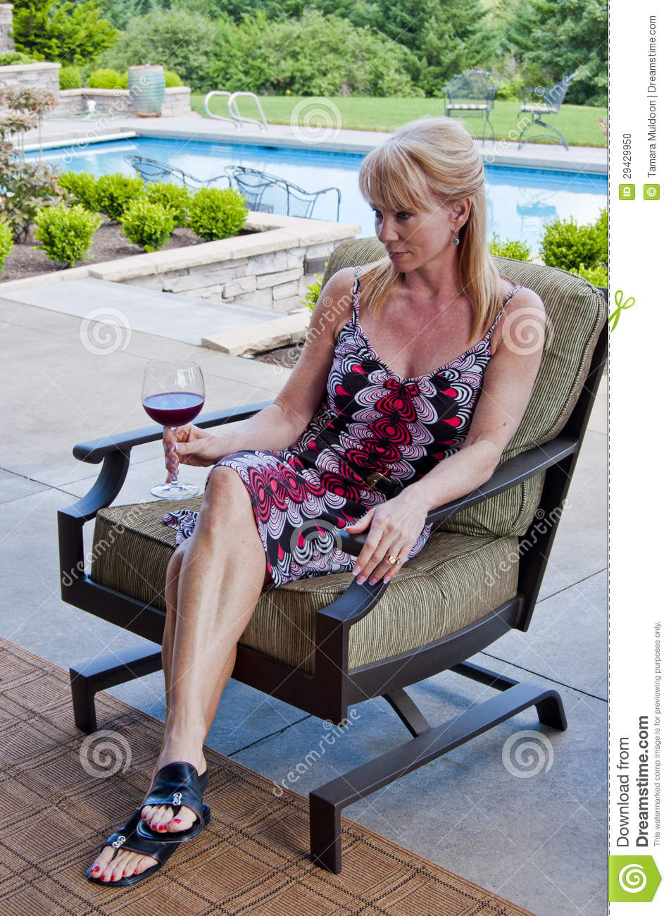 Woman On Patio With Wine Glass Stock Photo - Image: 29429950