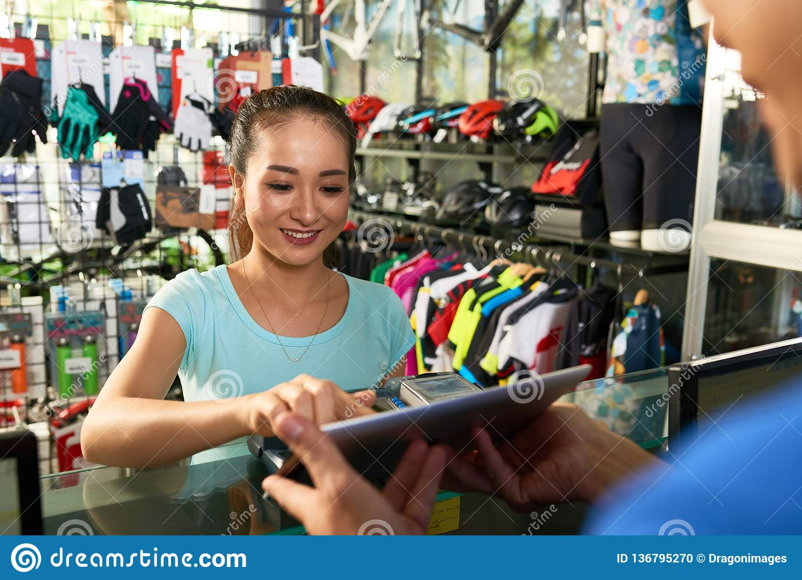 Woman paying in store