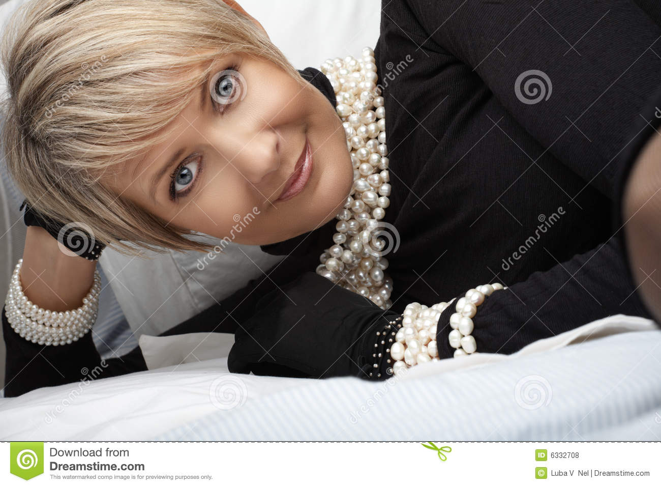 Woman in pearls in her 40s