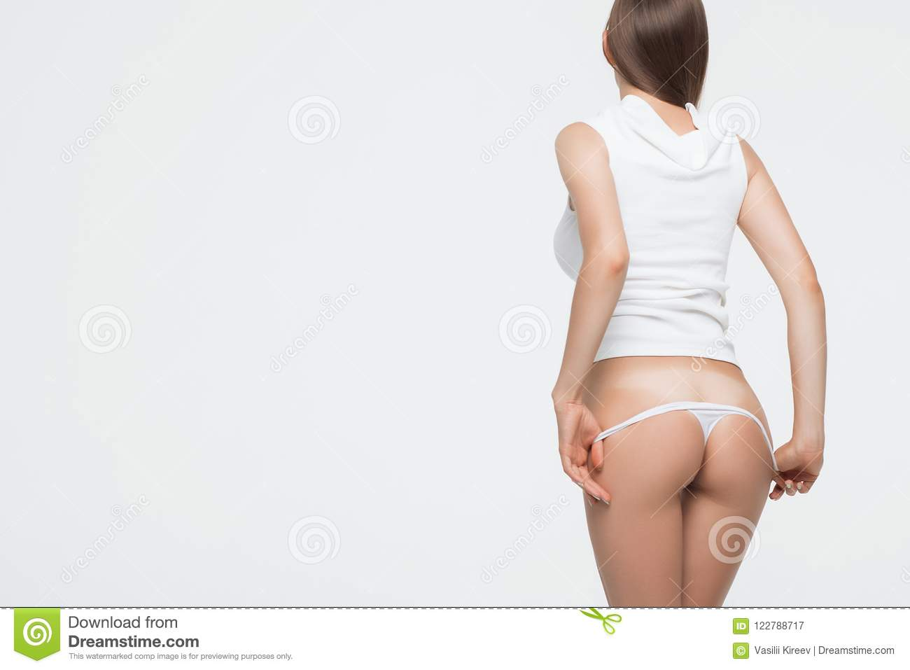 409c111693 Crop back view of anonymous seductive female standing and removing thong
