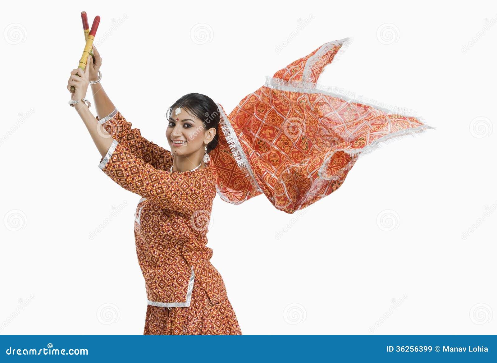 Indian Woman Performing Dandiya Cartoon Vector
