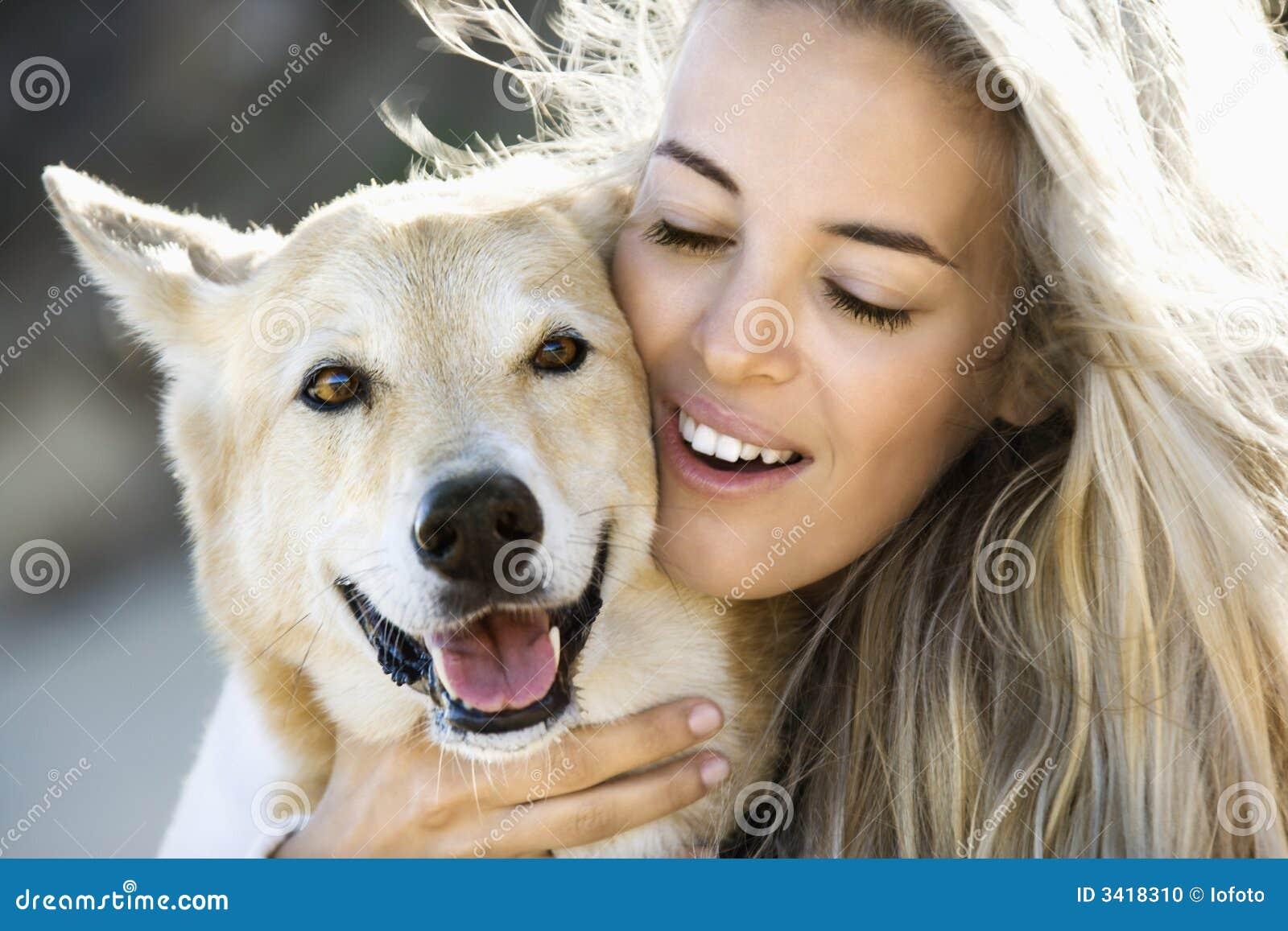 Woman Petting Dog. Stock Photo - Image: 3418310