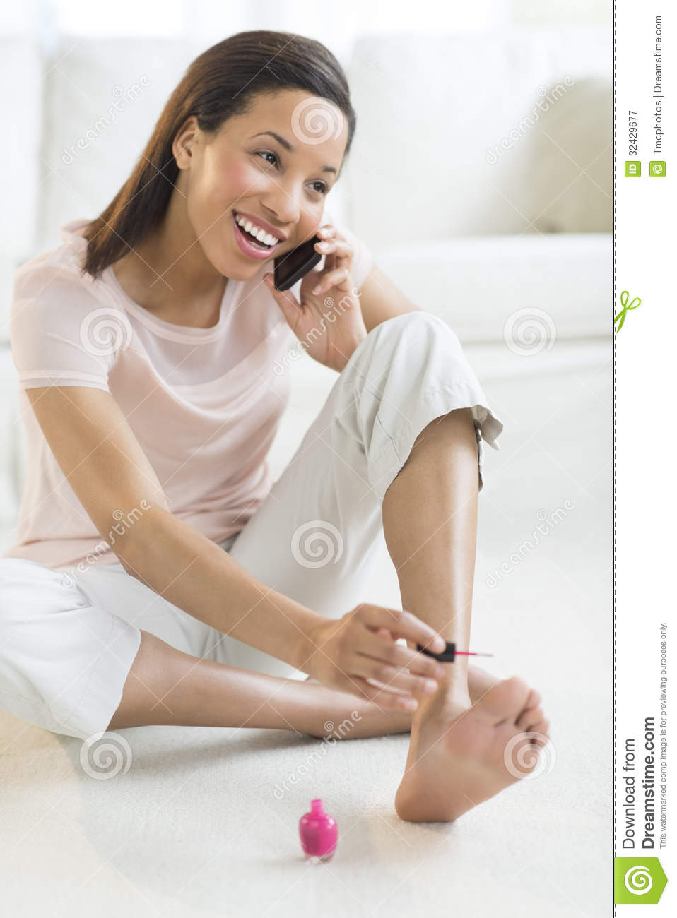 woman-phone-call-painting-toenails-home-full-length-happy-young-32429677.jpg