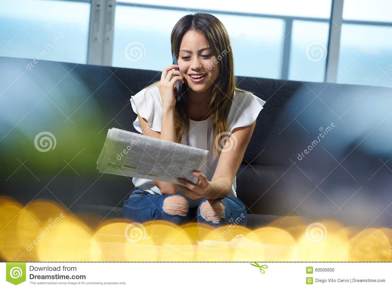 w phone calling for job announcement on newspaper stock photo w phone calling for job announcement on newspaper