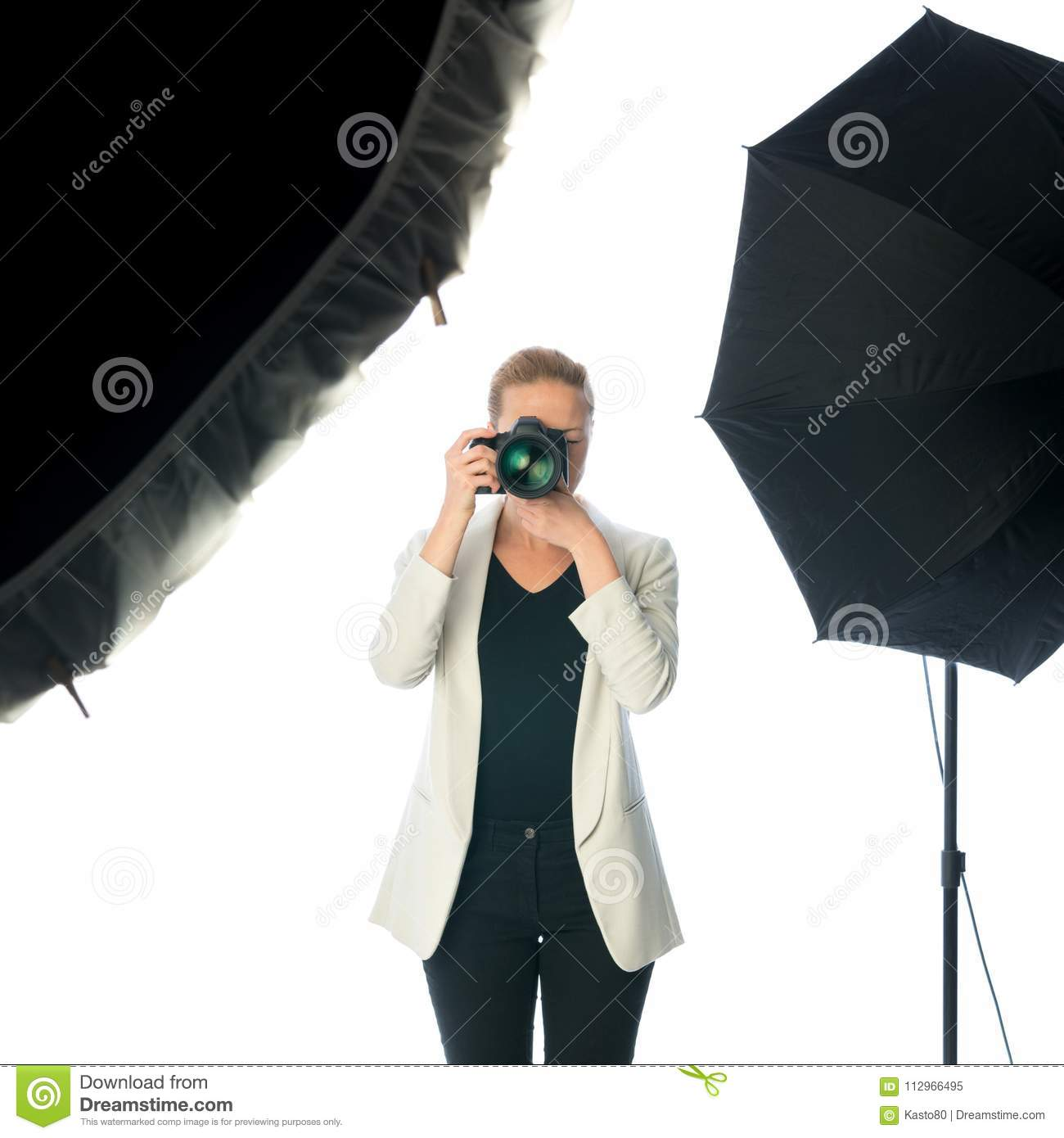 Download Woman Photographer Takes Images With Dslr Camera In Photo Studio Stock Image