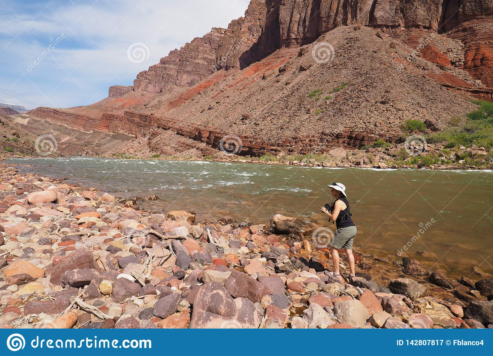 Woman photographing the Colrado River and inner canyon in the Grand Canyon.