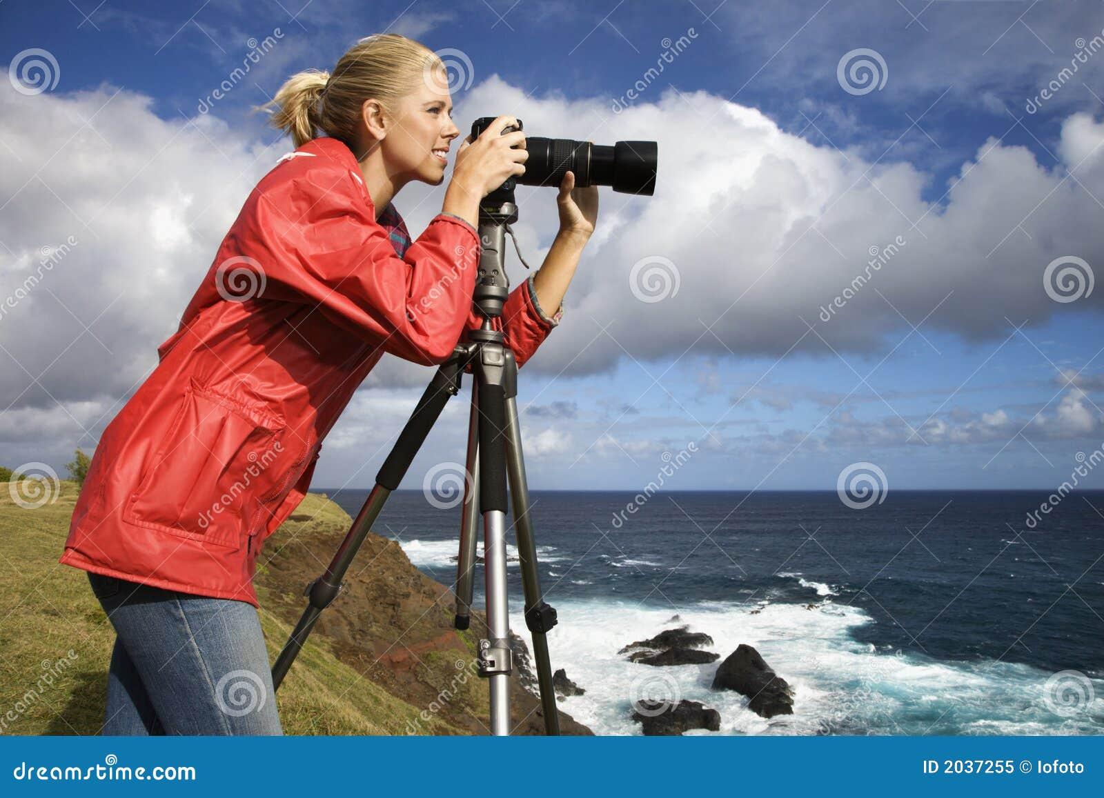 Woman photographing scenery in Maui, Hawaii.