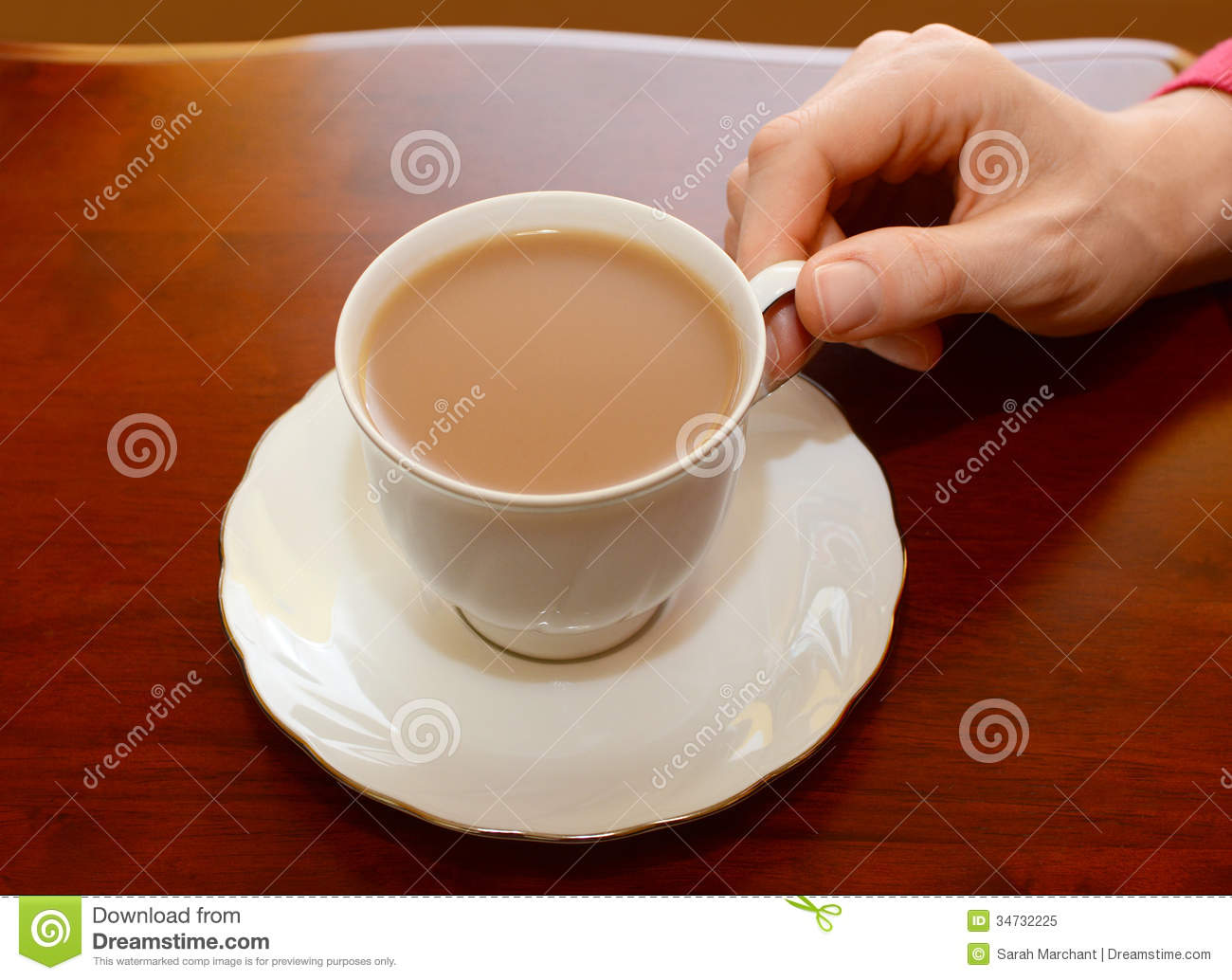 ... Cup Of Tea From A Table Royalty Free Stock Photo - Image: 34732225
