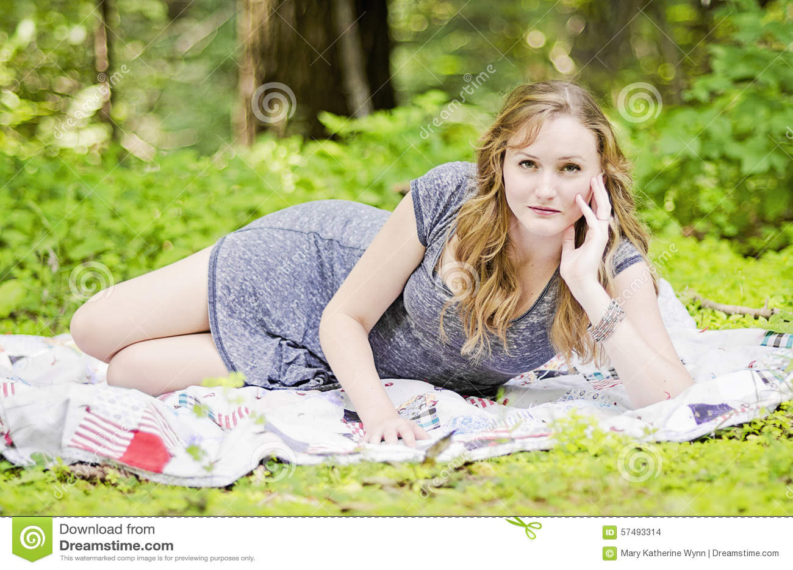 Woman on picnic blanket