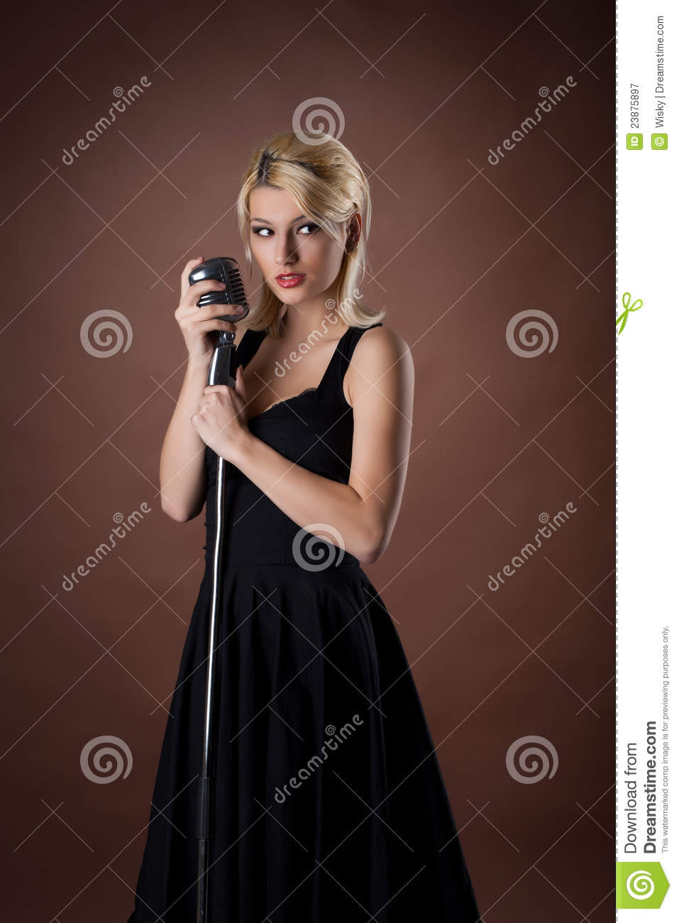 Woman pin-up portrait in black with microphone