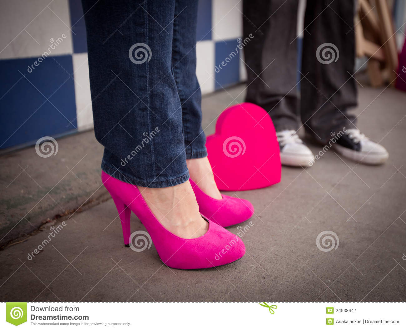 Woman With Pink Heels And Man In Black Chucks Royalty Free Stock ...