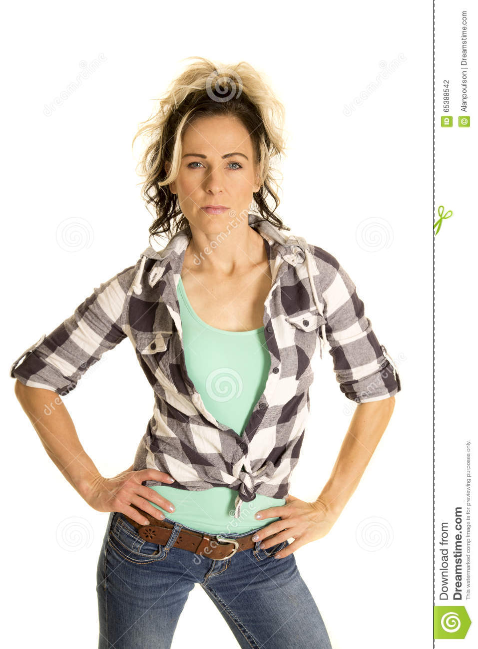 Woman in plaid shirt hands on hips serious