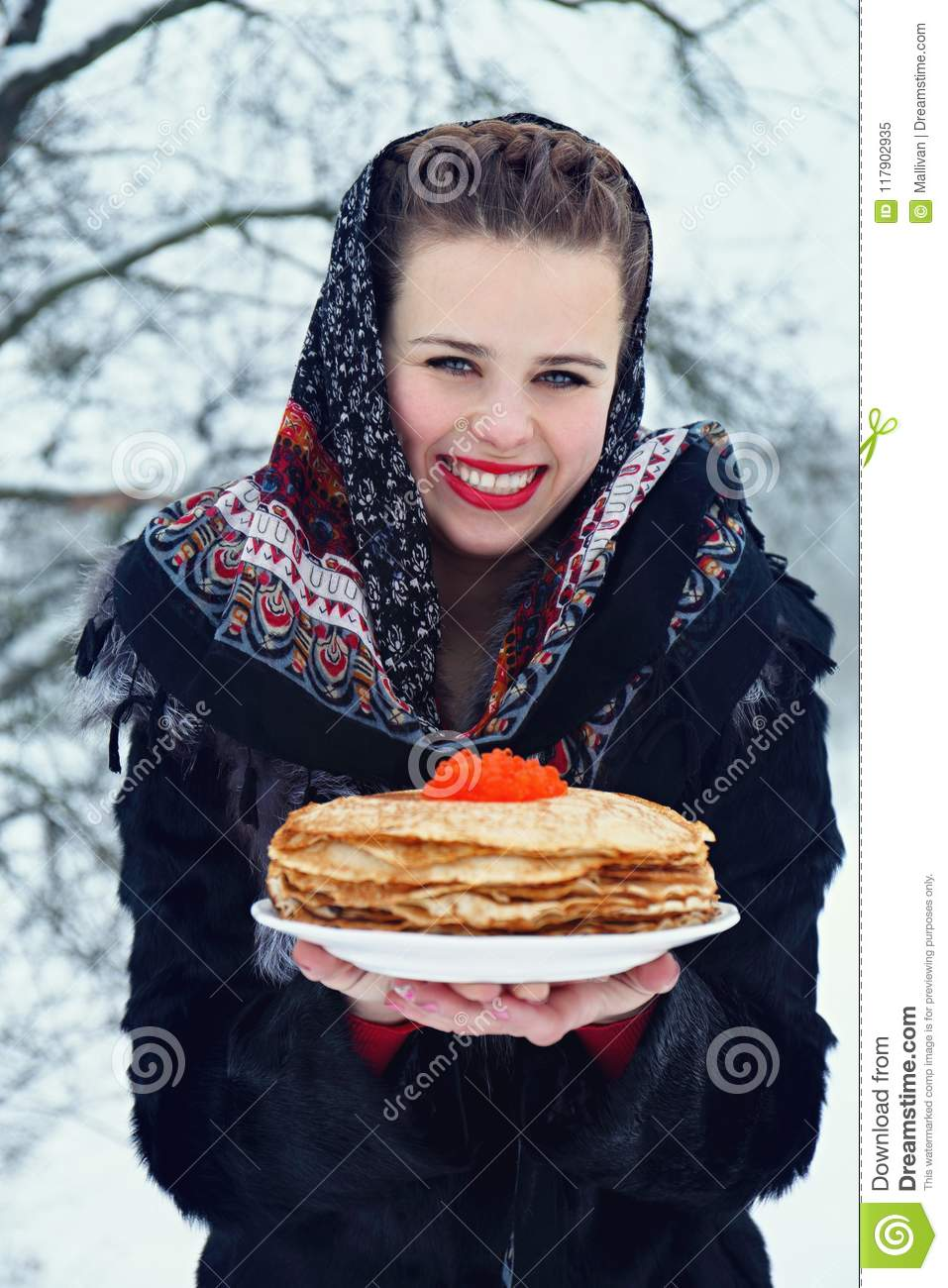 Woman with a plate of pancakes