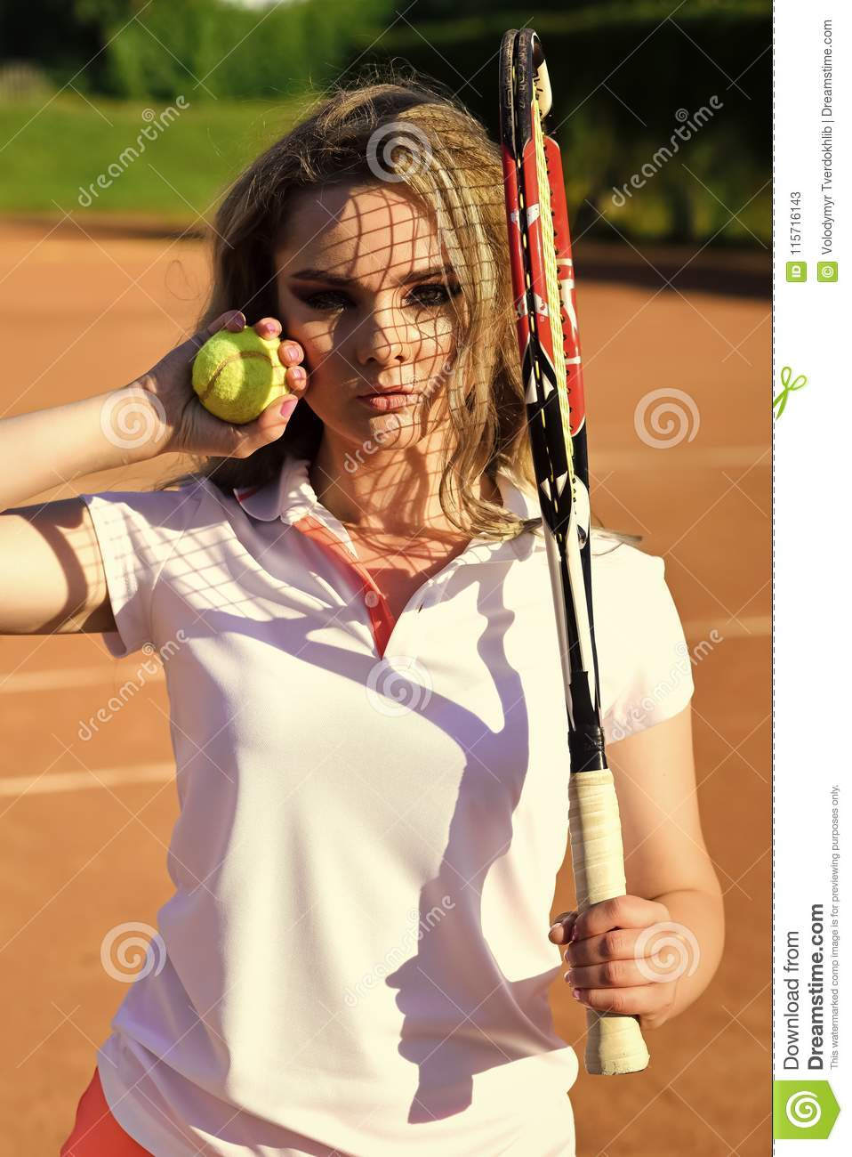 Woman player with tennis racket and ball on court. Girl with net shadow on  face on sunny day. Fashion 1984a1ce82
