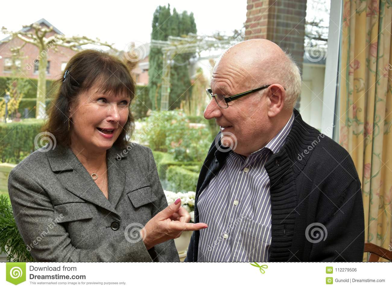 Woman Playfully Scolding A Man Stock Photo Image Of Laughing
