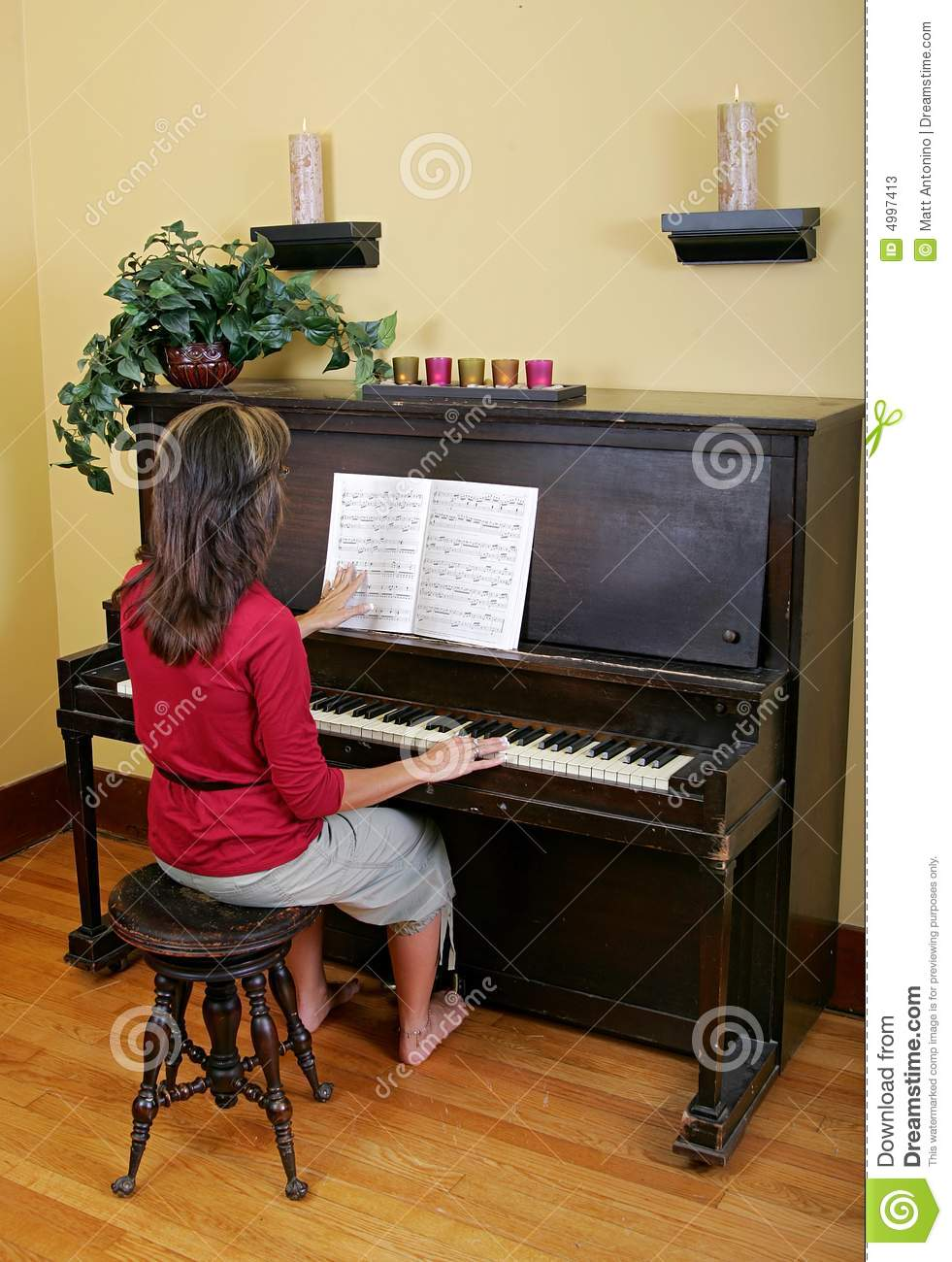 Woman Playing The Piano Stock Photos Image 4997413