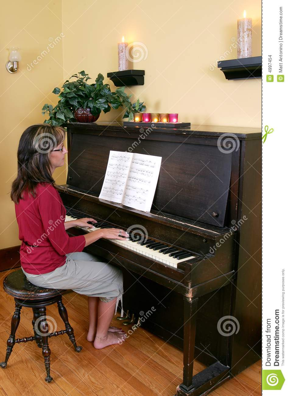 Tune Up Prices >> Woman Playing The Piano Stock Images - Image: 4997454