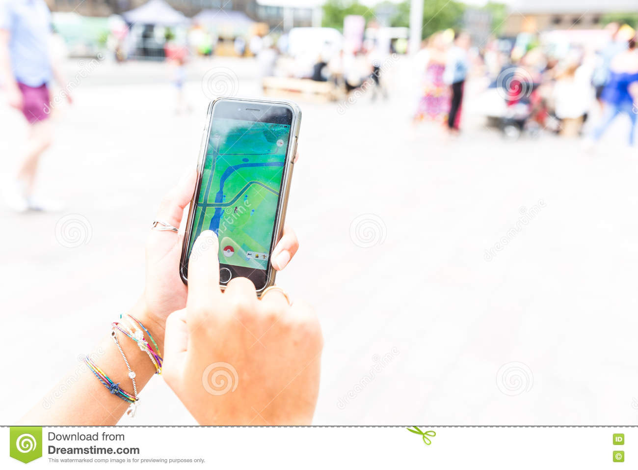 Woman Playing With Pokemon Go App Editorial Stock Image