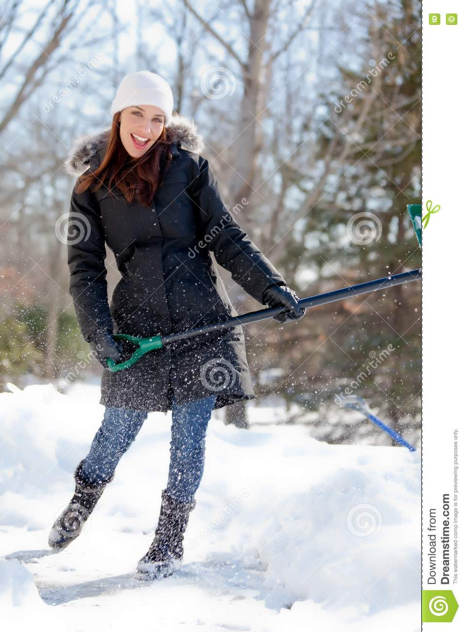 woman playing while shoveling snow royalty free stock
