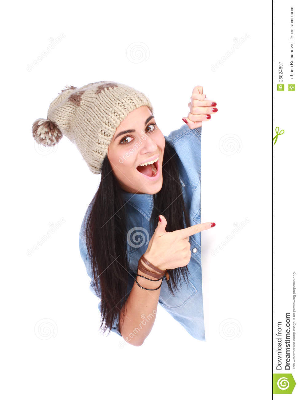 Woman pointing her finger at white billboard
