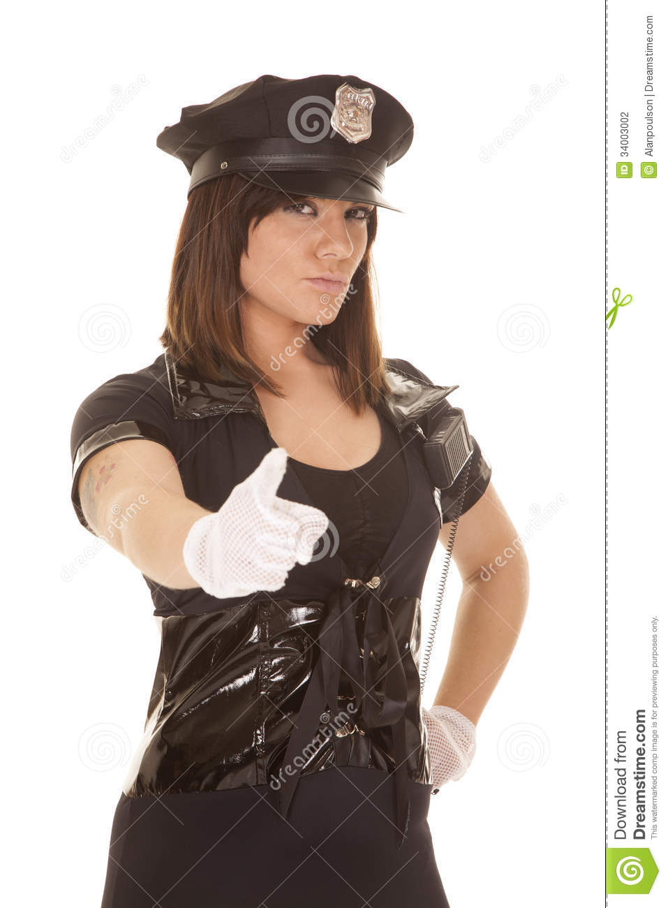 police woman with a serious expression on her face pointing her ...