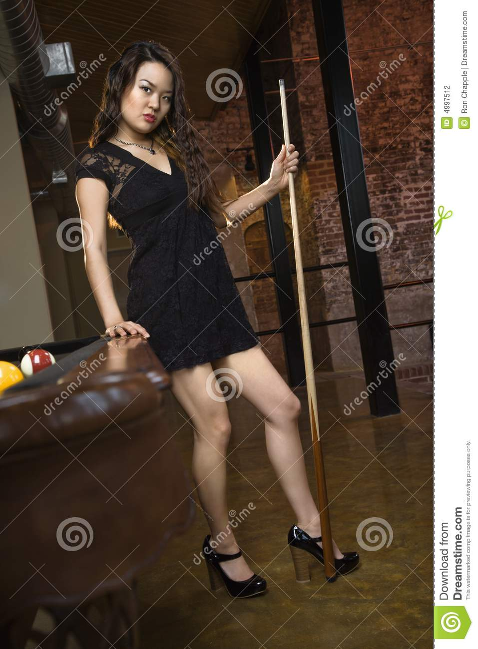 woman with pool stick stock photography