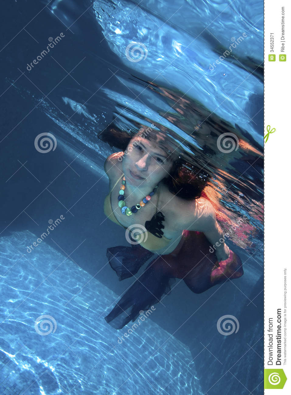 Young woman swimming underwater