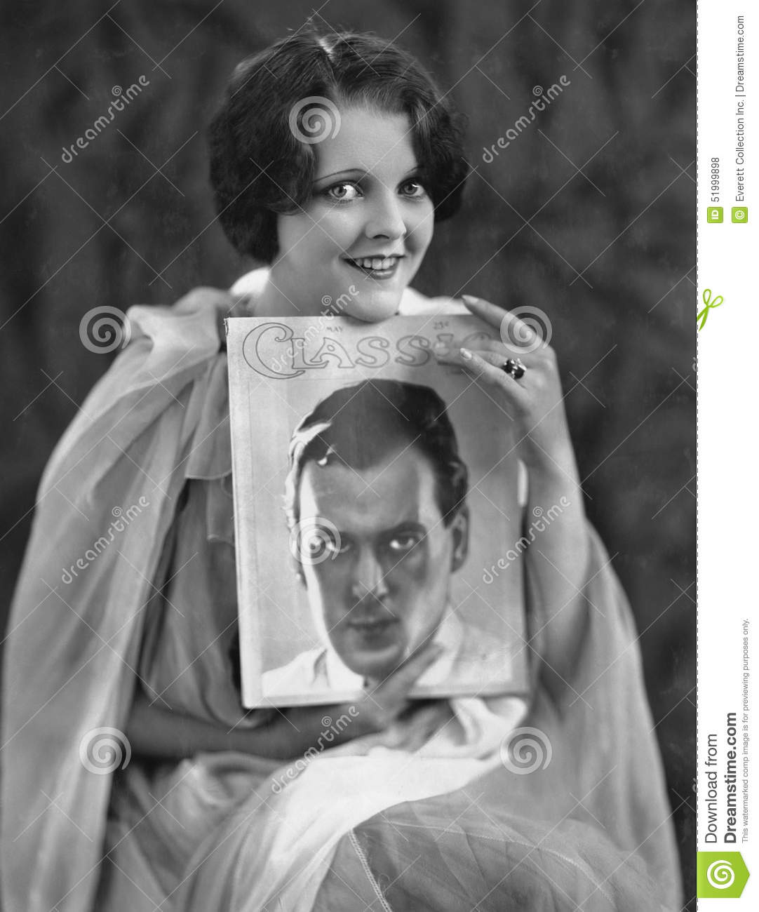 Woman with portrait of man on magazine cover