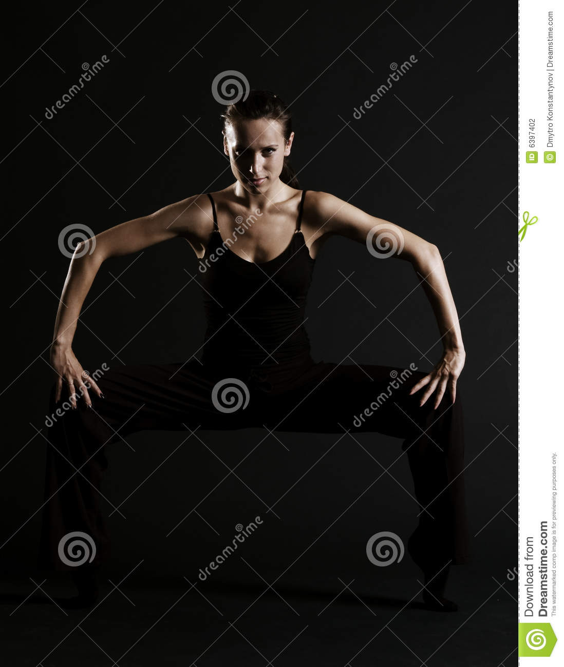 Woman posing against black background
