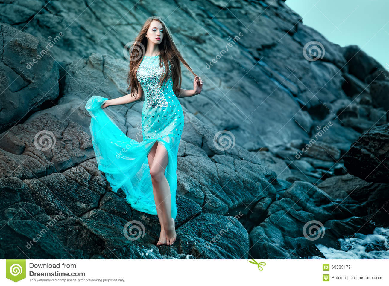 Download Woman Posing On A Beach With Rocks Stock Image - Image of hair, adult: 63303177