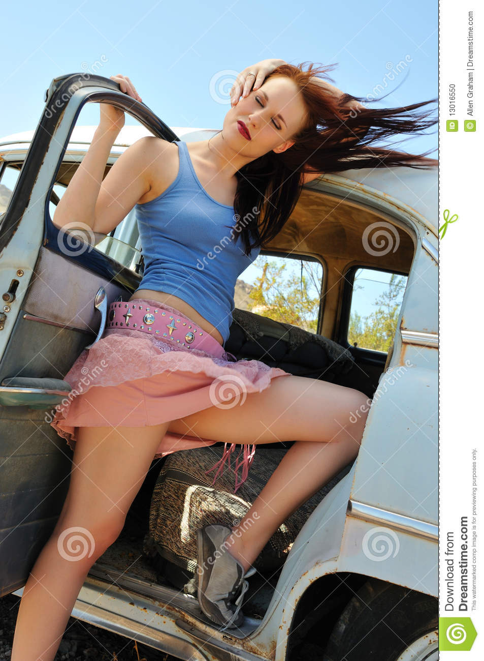 Woman Posing Next To An Old Time Auto Stock Photo Image