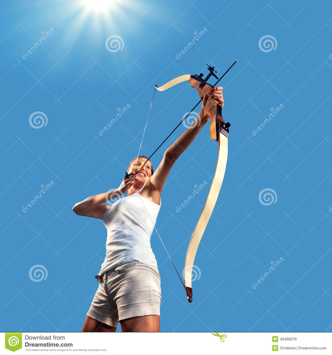 Woman practicing with bow and arrow