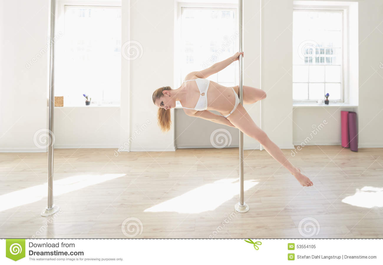 Woman Practicing Pole Dance In A Pole Fitness Cl Stock ...