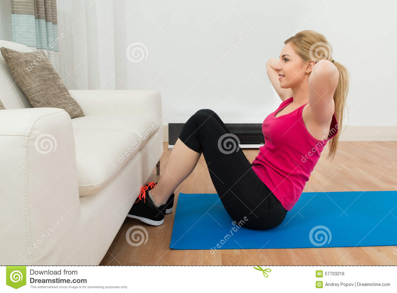 Woman practicing yoga stock photo image of living for Living room yoga timetable