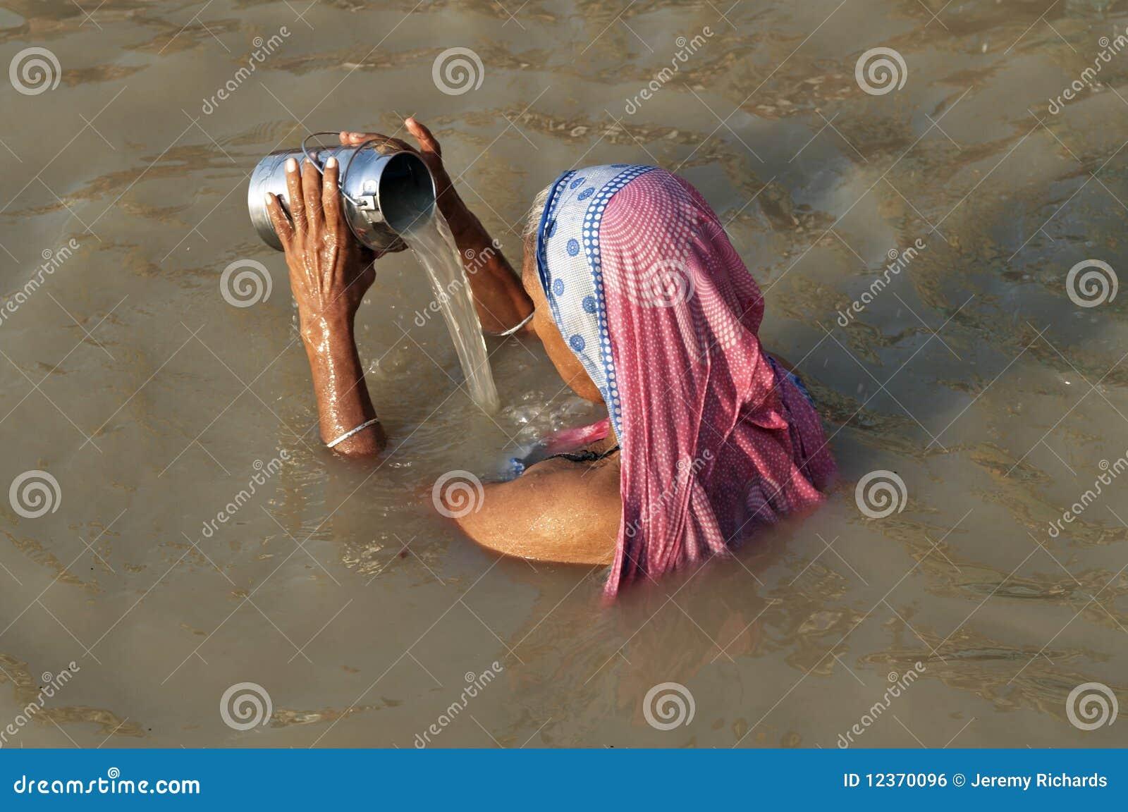 Woman Praying At Varanasi