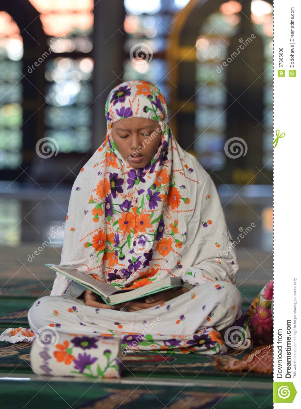 A woman prays in the mosque