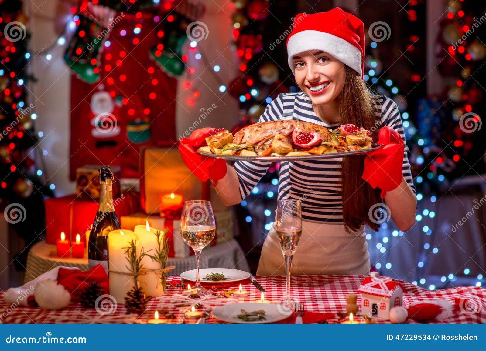 Woman Preparing For Christmas Dinner Stock Photo - Image: 47229534