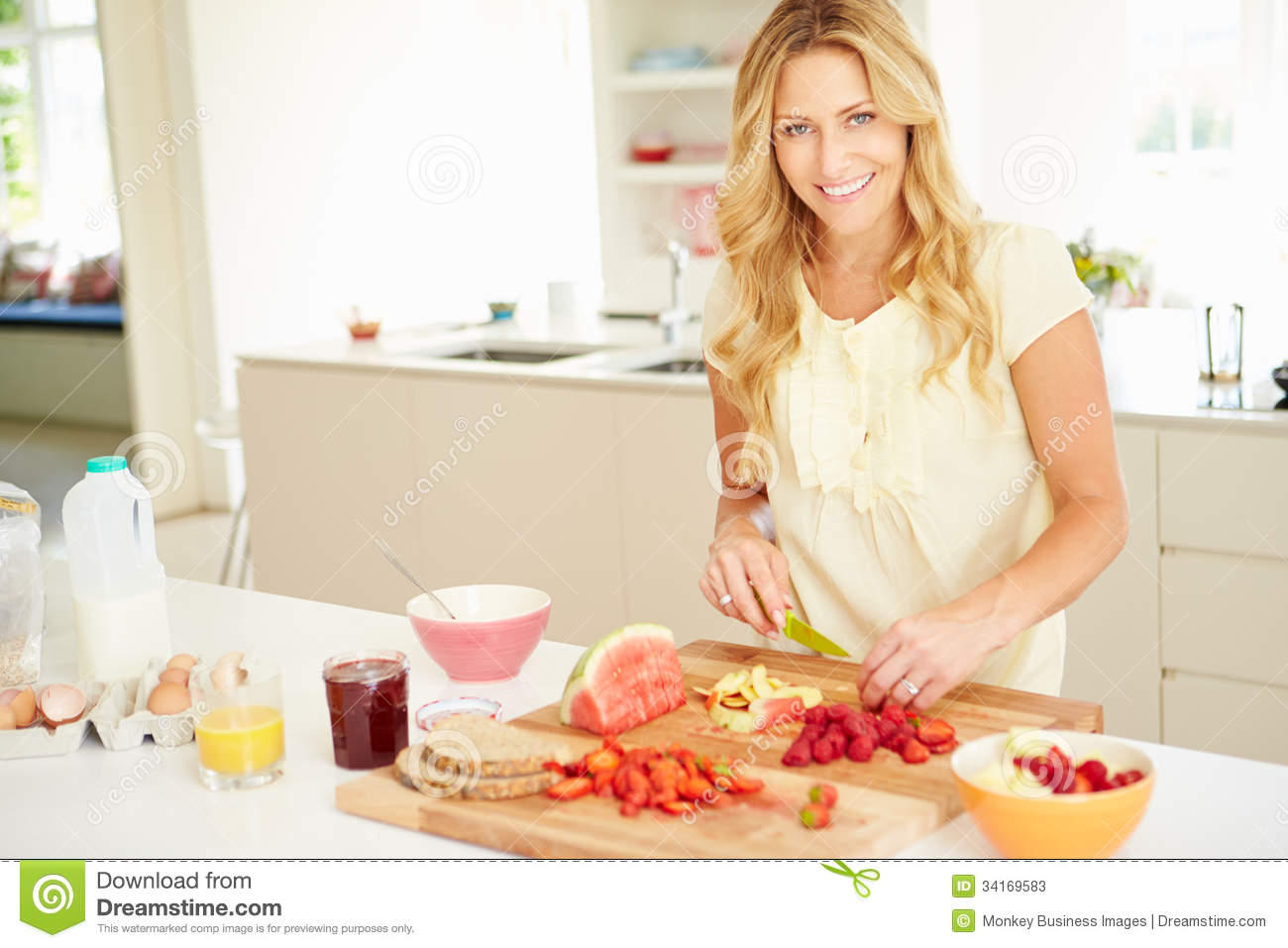 Woman Preparing Healthy Breakfast In Kitchen Stock Image - Image of ...