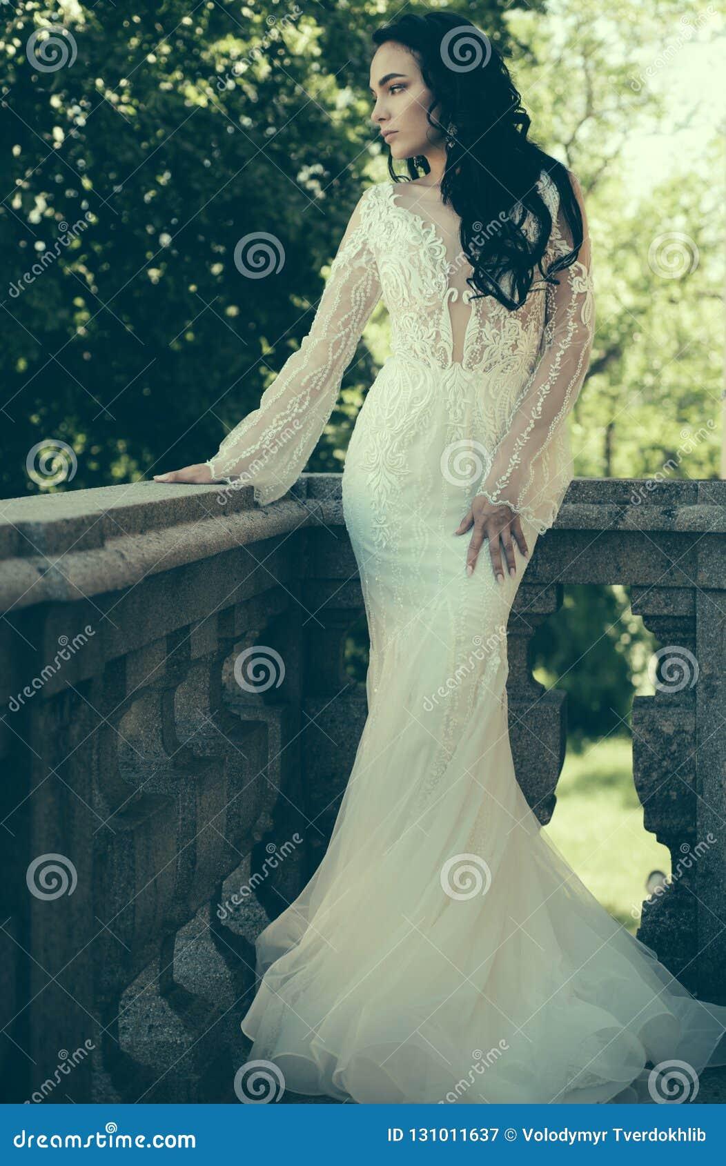 Woman is preparing for wedding. Happy bride before wedding. Wonderful bridal gown. Beautiful wedding dresses in boutique