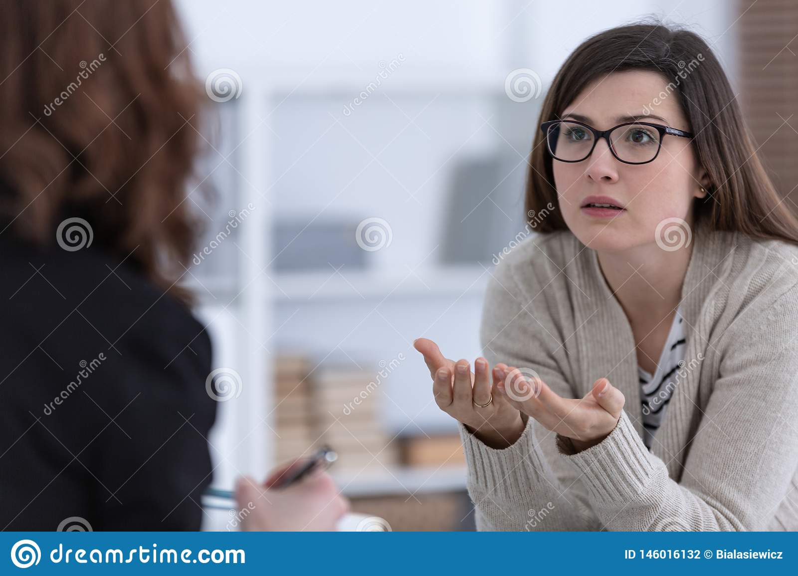 Woman with problem and counselor during therapy session