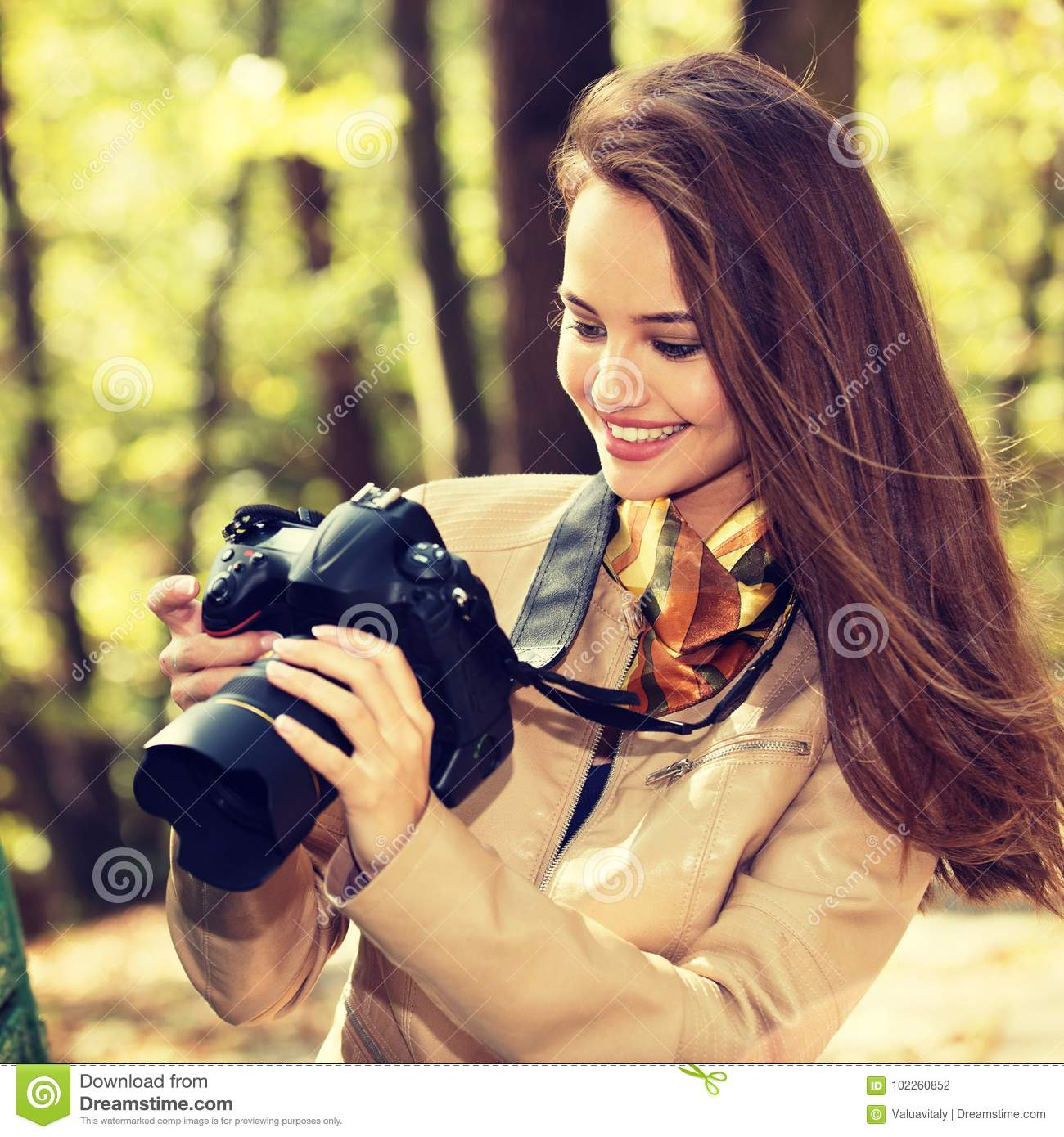 Woman Is A Professional Photographer With Photo Camera Stock