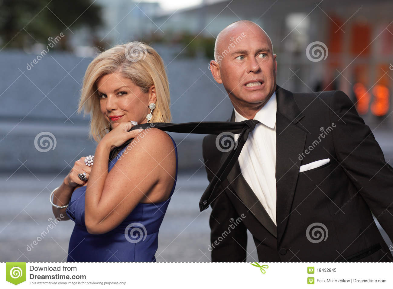 Woman Pulling Her Boyfriend By The Tie Royalty Free Stock