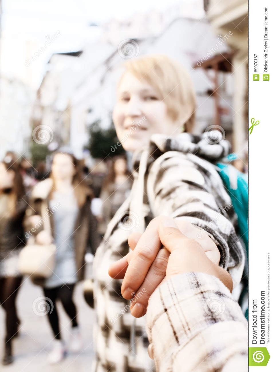 Woman Pulling Someone Hand And Walking Toward Crowded City Street