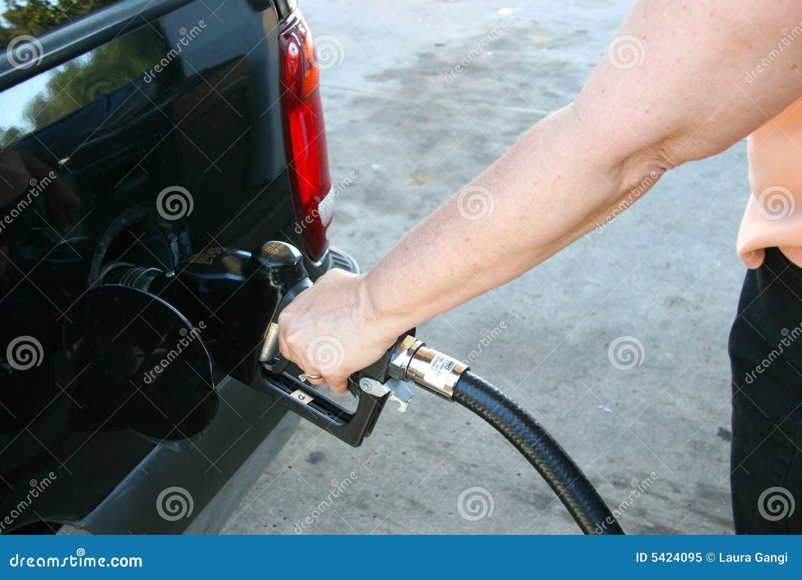 Girls pumping gas