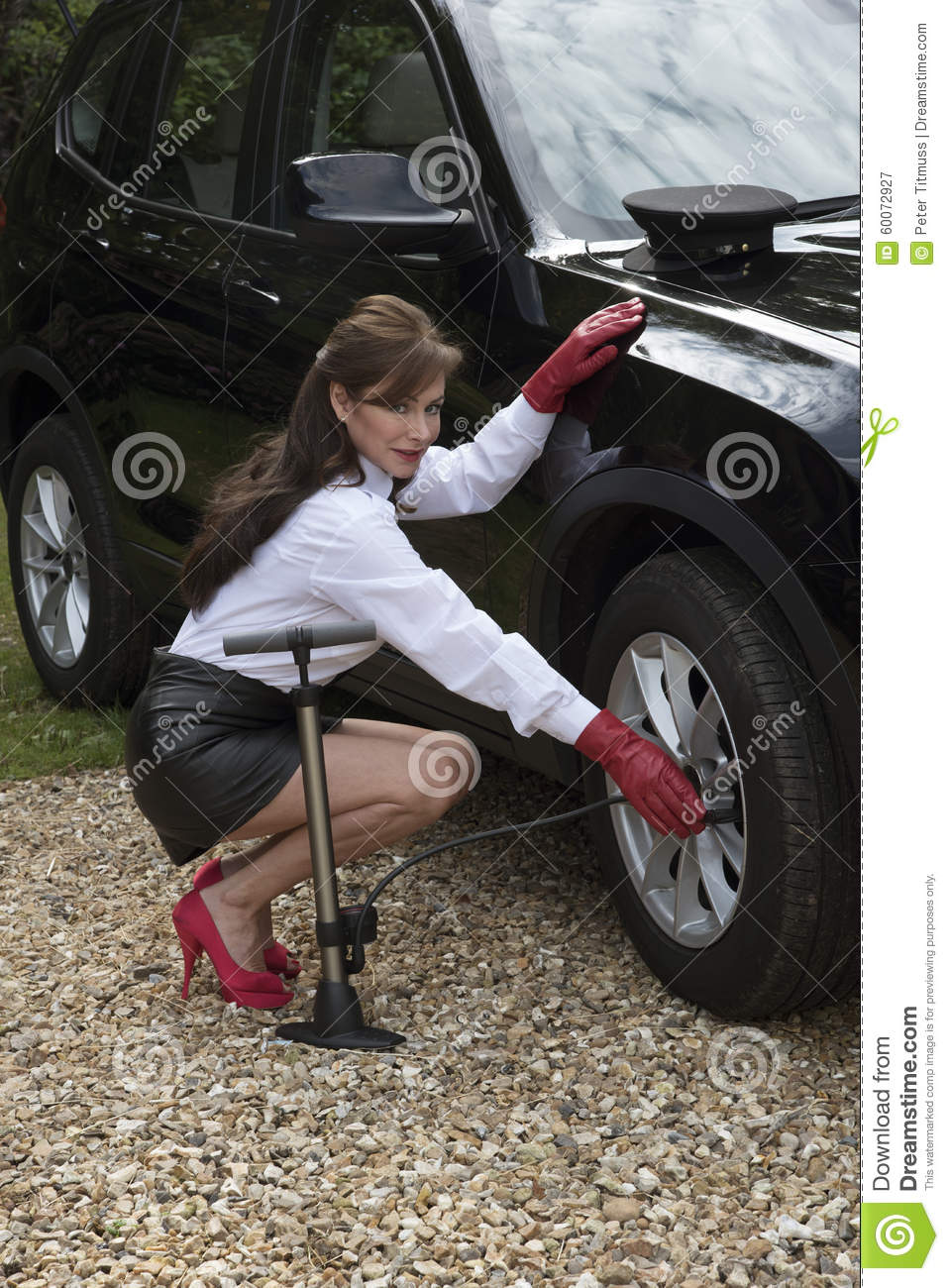 Checking Tire Pressure >> Woman Pumping Up Car Tyre Stock Photo - Image: 60072927