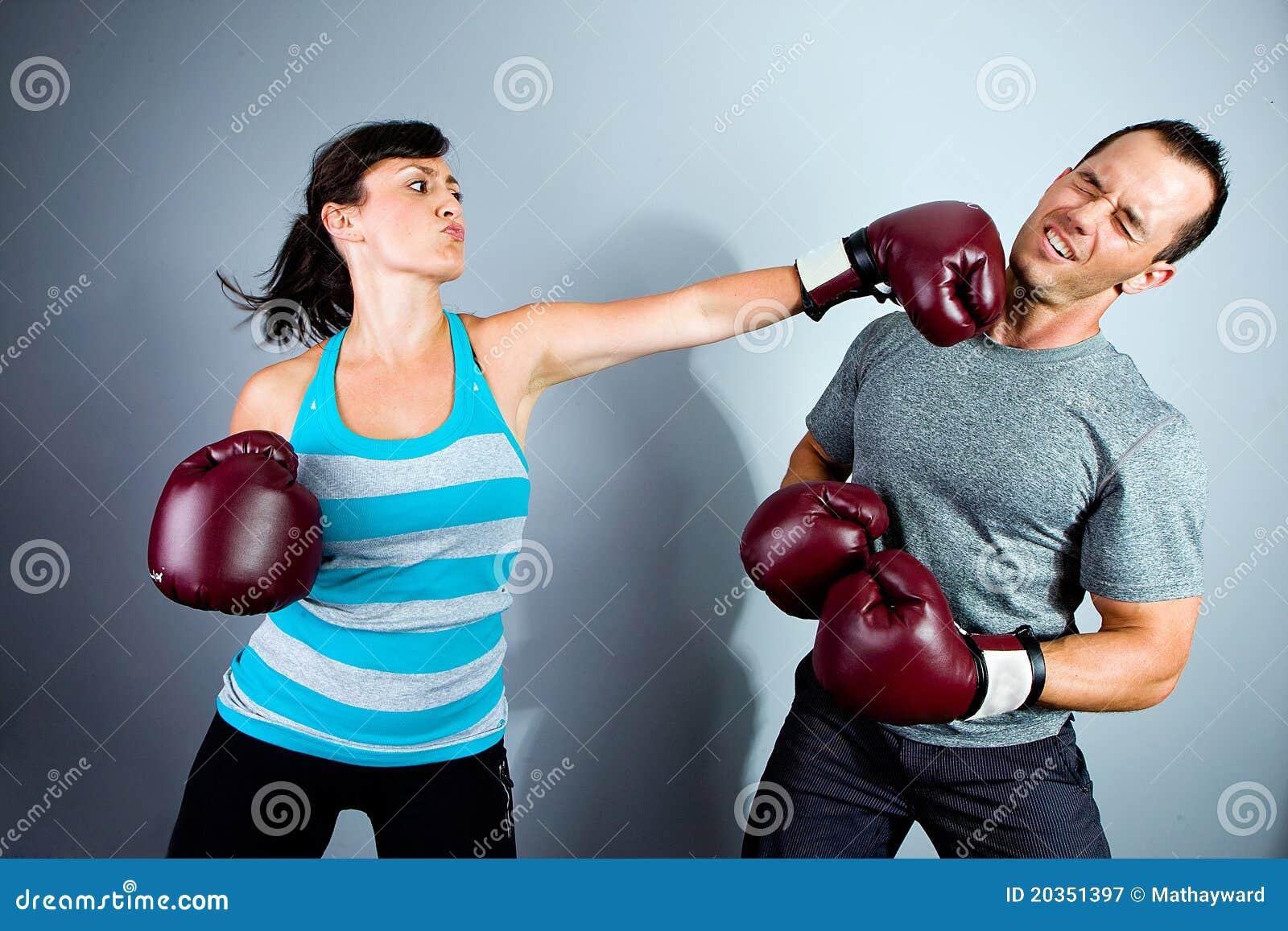 man punching woman