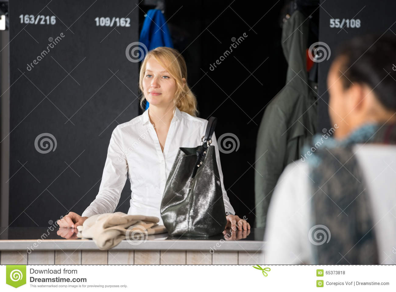 Woman With Purse Standing At Bag Deposit Counter