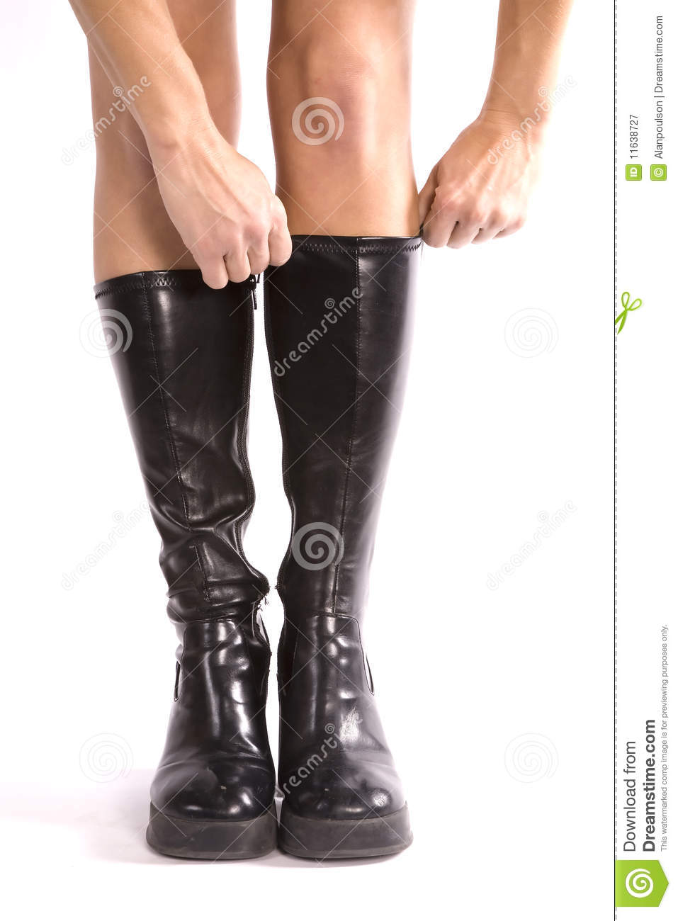 putting on black boots royalty free stock