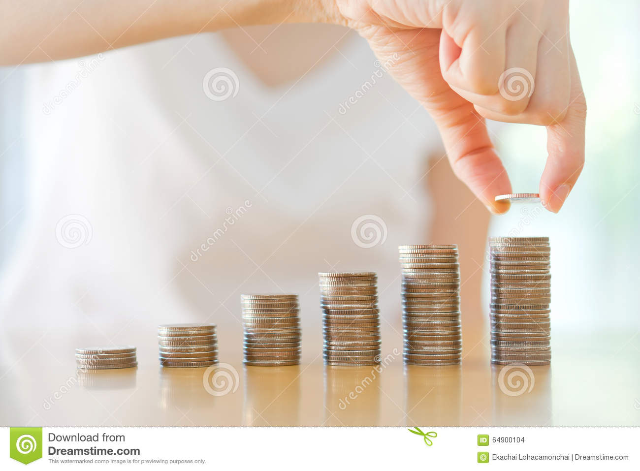 Woman Putting Coin To Rising Stack Of Coins